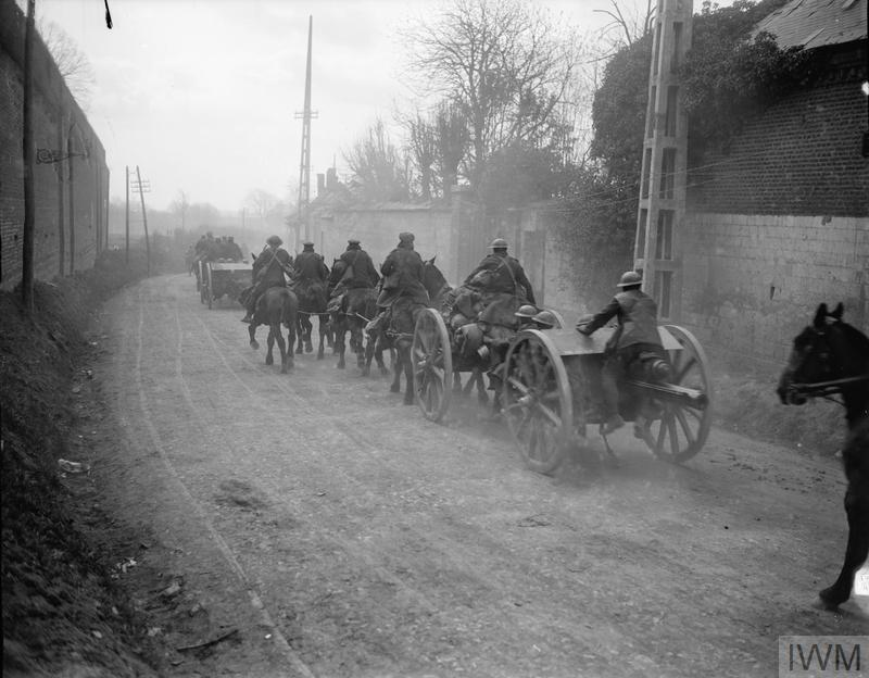 IWM Q 8632 Royal Field Artillery passing through Mailly-Maillet to meet the German advance 26 Mar 1918