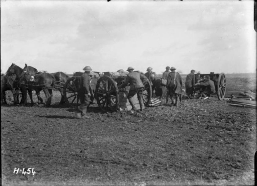 nzlimage 1-2 013074-G soldiers firing shells near Mailly-Maillet, 1 April 1918