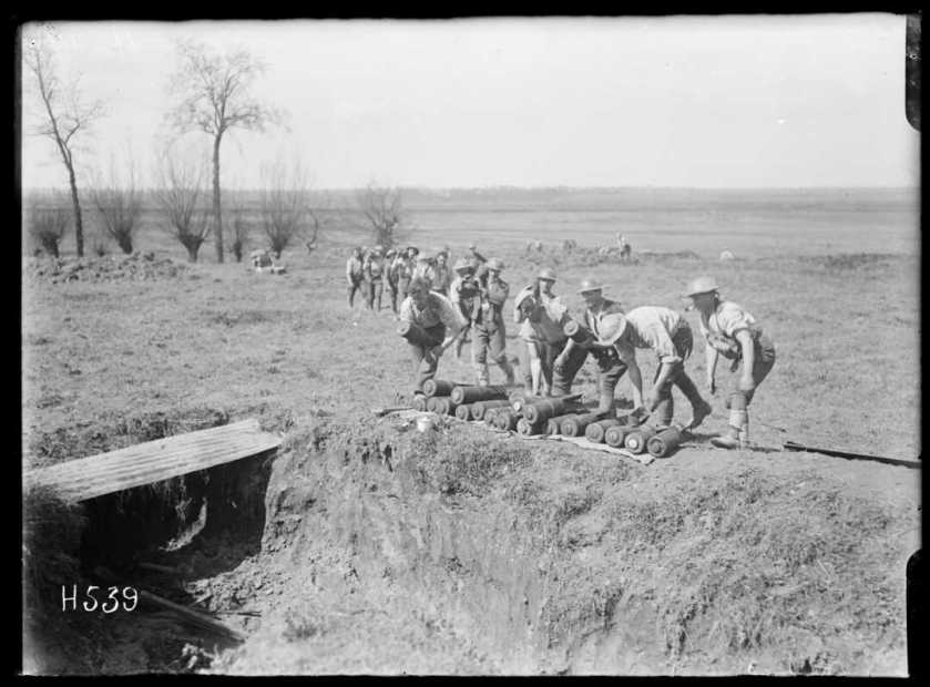 1-2 013156-G Soldiers carry mortar shells 15 April 1918