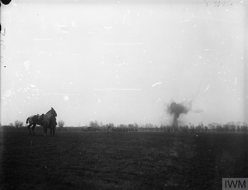 IWM (Q 10877) Battle of Estaires. German shell bursting in distance, 10 April 1918