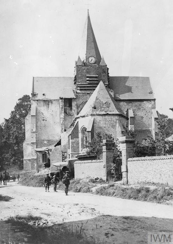 IWM (Q 60809) British troops passing by the church at Mailly-Maillet, 23 August 1918