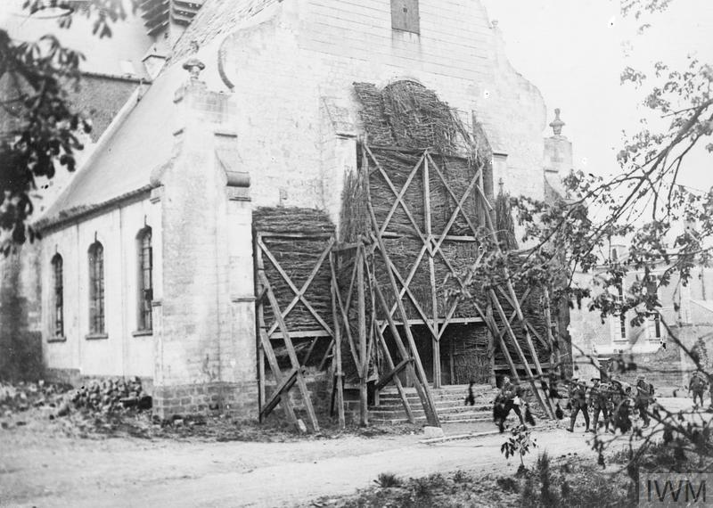 IWM (Q 60811) Entrance of the church at Mailly-Maillet, showing brushwood protection on stained glass windows, 29 April 1918