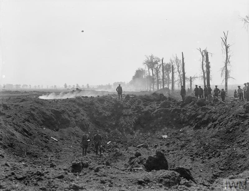 IWM (Q 11473) Crater caused by explosion of British ammunition dump at Wardrecques, 19 May 1918