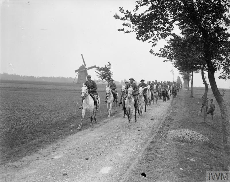 IWM (Q 8952) Royal Scots Greys riding their horses on a road at Brimeux, 25 May 1918
