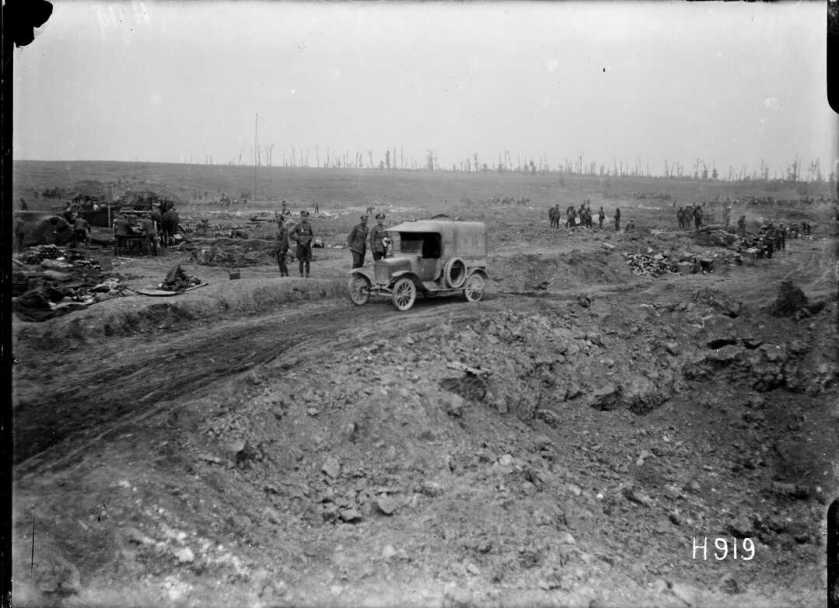 nlnzimage 1-2 013495-G Motor car passing a huge shell hole in captured ground, Grevillers, 24 Aug 1918