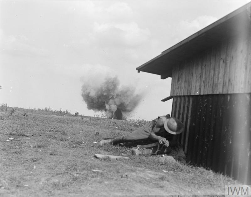 IWM (Q 11255) Soldier NZ Division takes cover as shell bursts, Grevillers, 25 Aug 1918