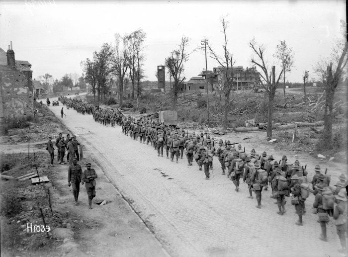 nlnzimage 1-2 013604-G NZ battalion passing through Bapaume, 14 Sep 1918