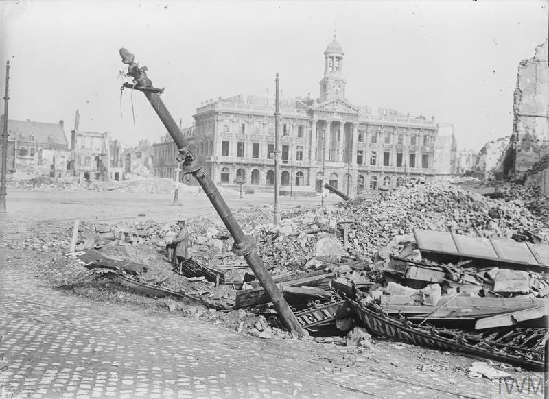 IWM (Q 3314) Main square in Cambrai, showing damaged buildings and the town hall, 23 October 1918
