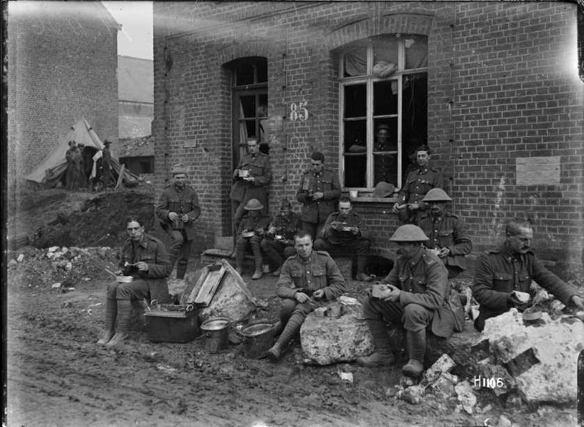 nlnzimage 1-2 013663-G Soldiers Wellinton Regiment sitting eating, Solesmes, 9 Nov 1918