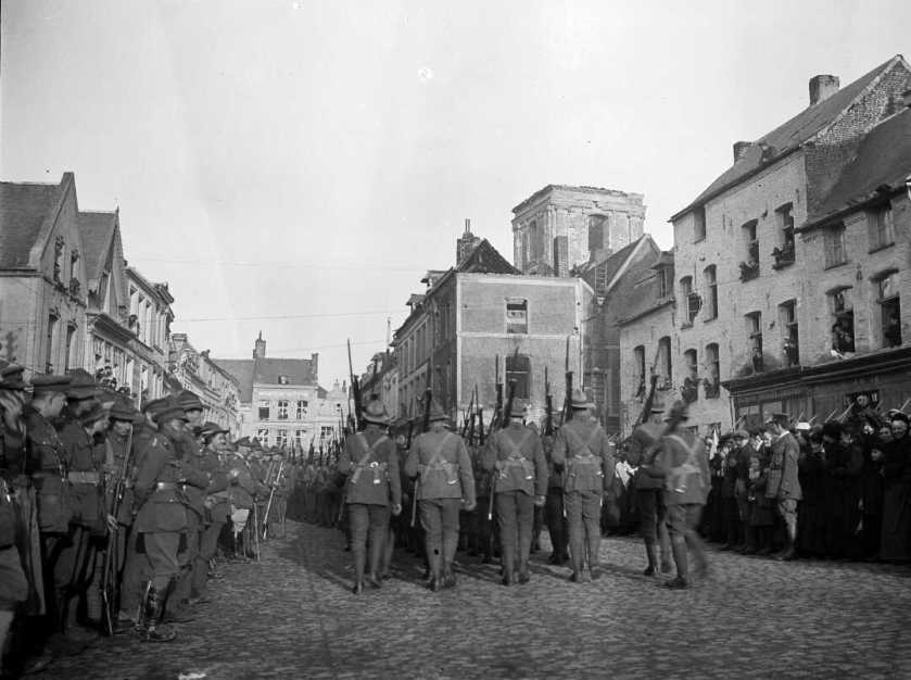 nlnzimage 1-4 017543-F NZ troops marching through Le Quesnoy, 10 Nov 1918