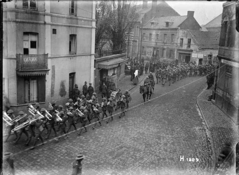 nlnzimage 12-013776-G NZ Troops parading Solesmes, late Nov 1918